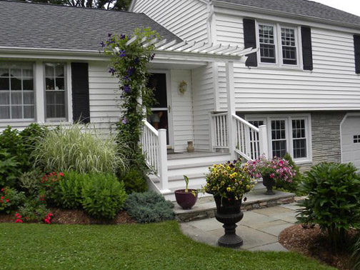 Landscaping ideas split level homes pdf for Bi level house with front porch